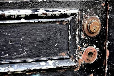 Photograph - Peeling Black Paint And Old Locks by Nadalyn Larsen