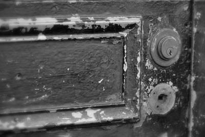 Photograph - Peeling Paint And Old Locks In Black And White by Nadalyn Larsen