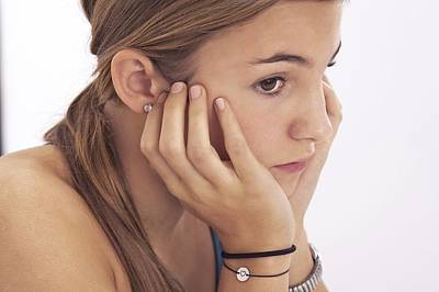 Pierced Ears Photograph - Pensive Teenage Girl by Science Photo Library