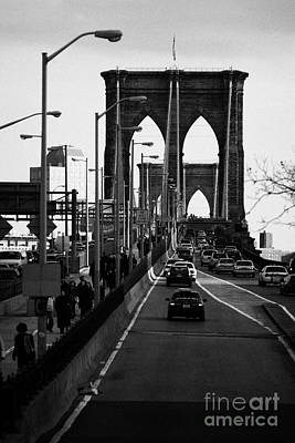 people and traffic crossing the Brooklyn bridge in the evening new york city Print by Joe Fox