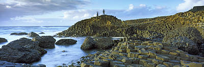 County Antrim Photograph - People Climbing On Rocks At Giants by Panoramic Images
