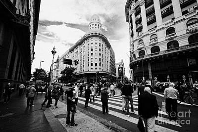 people crossing calle florida Edificio Bencich and south end of florida street downtown Buenos Aires Print by Joe Fox