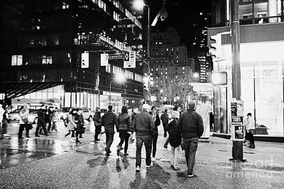Crosswalk Photograph - people crossing corner of granville and west georgia streets on a rainy night Vancouver BC Canada by Joe Fox