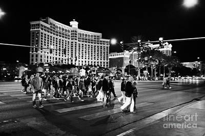 People Crossing Las Vegas Boulevard Outside The Bellagio At Night Nevada Usa Art Print by Joe Fox