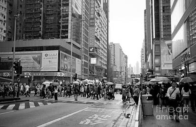 Shopping Center Photograph - People Crossing The Street On A Rainy Day In Mong Kok Hong Kong by Ivy Ho