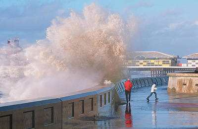 Durst Photograph - People Dodging Storm Waves by Ashley Cooper