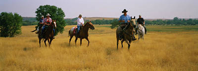 Horseback Photograph - People Horseback Riding, North Dakota by Panoramic Images