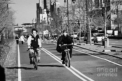 Joe Dimaggio Photograph - people mountain bikes exercising on bikeway next to West Side Highway new york by Joe Fox