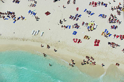 Latin America Photograph - People On The Shoreline Of A Tropical by Tommy Clarke