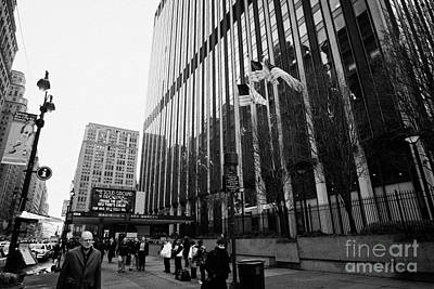 people on the sidewalk outside madison square garden with US flags flying new york city Art Print by Joe Fox