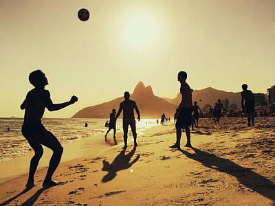 Photograph - People Playing Football At Ipanema by Alexander Spatari