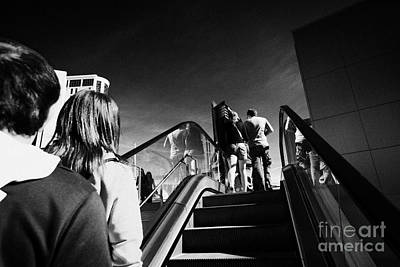 people riding on escalators on Las Vegas boulevard Nevada USA Art Print by Joe Fox