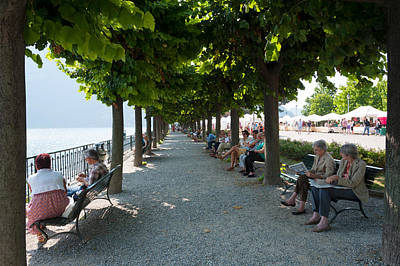 Lake Como Photograph - People Sitting On Benches Among Trees by Panoramic Images