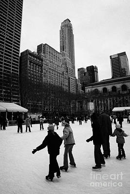 people skating on the ice at Bryant Park ice skating rink new york city Art Print