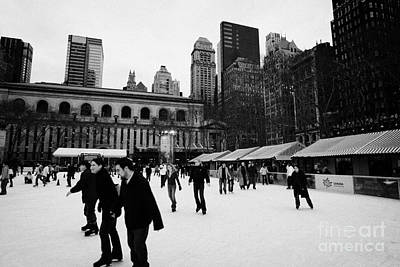 people skating on the ice at Bryant Park ice skating rink new york Art Print by Joe Fox
