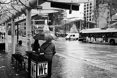 Busstop Photograph - people standing in the rain waiting for a bus on burrard street downtown Vancouver BC Canada by Joe Fox