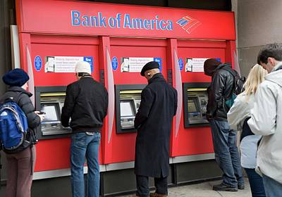 Atm Machine Photograph - People Using Cash Machines by Jim West