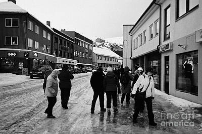 people walking along ice covered storgata main shopping street Honningsvag finnmark norway europe Print by Joe Fox