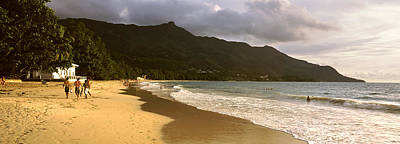 Walking In Tide Photograph - People Walking Along The Beau Vallon by Panoramic Images