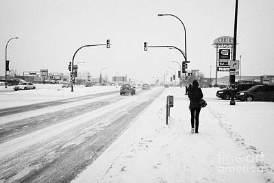 people walking and cars travelling along 8th street in blizzard conditions Saskatoon Saskatchewan Ca Art Print by Joe Fox