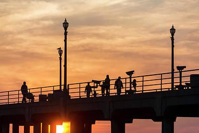 People Walking On Pier Art Print by Roberto Lopez