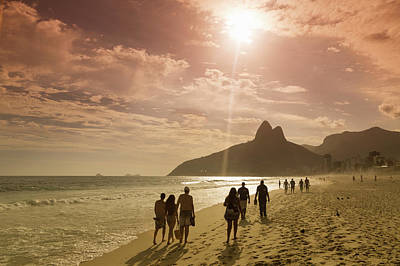 Photograph - People Walking On The Beach At Sunset by Buena Vista Images