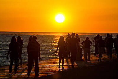 Photograph - People Walking On Waterfront On Sunset by Brch Photography