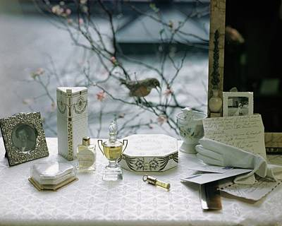 Wildlife Photograph - Perfume And Accessories On A Vanity Table by Frances McLaughlin-Gill