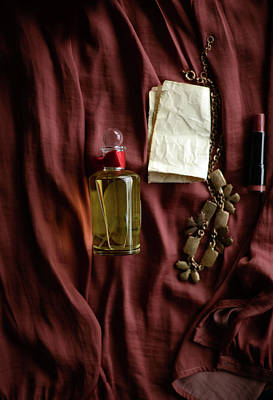 Photograph - Perfume Bottle, Necklace And Lipstick by Kristina Strasunske