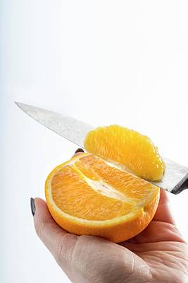 Person Slicing An Orange Art Print