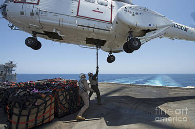 Personnel Attach A Cargo Hook To An Art Print by Stocktrek Images