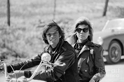 Peter Fonda And Nancy Sinatra On A Motorcycle Art Print by The Harrington Collection