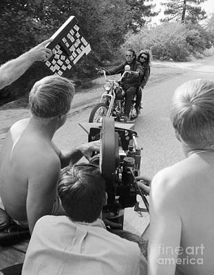 Peter Fonda And Nancy Sinatra With Film Crew Art Print by The Harrington Collection