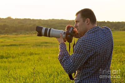 Artist Working Photograph - Photographer With Camera by Aleksey Tugolukov