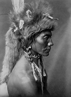 Portraits Royalty-Free and Rights-Managed Images - Piegan Indian circa 1910 by Aged Pixel