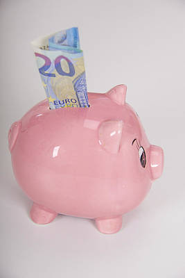Piggy Bank Wall Art - Photograph - Piggy Bank With A Twenty Euro Note by Lea Paterson/science Photo Library
