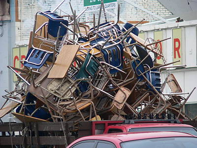 Photograph - Pile Of Old Desks And Chairs by Jeff Lowe