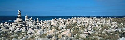 Balance Of Nature Photograph - Piles Of Stones At The Coast by Panoramic Images