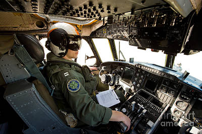 Greyhound Photograph - Pilot Sits In The Pilot Seat Of A C-2 by Stocktrek Images
