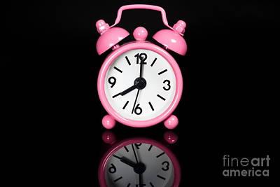 Pink Alarm Clock Print by Niphon Chanthana