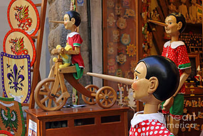 Toy Shop Photograph - Pinocchio Inviting Tourists In Souvenirs Shop by Kiril Stanchev