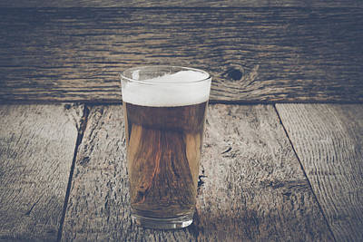 Beer Royalty-Free and Rights-Managed Images - Pint of Pilsner Beer on Wood Background with Vintage Instagram F by Brandon Bourdages