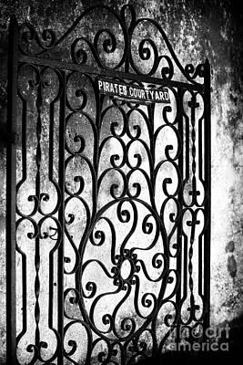 Photograph - Pirates Courtyard by John Rizzuto