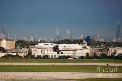 319 Photograph - Plane Landing In Chicago by Jason Feldman