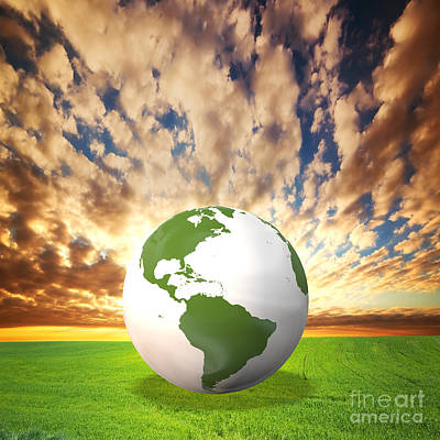Conceptual Photograph - Planet Earth Model On Green Field At Sunset by Michal Bednarek