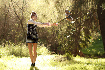 Floating Girl Photograph - Playing Doll by Kevin Schlanser
