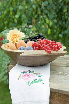 Plums, Apricots And Berries In Wooden Bowl Art Print