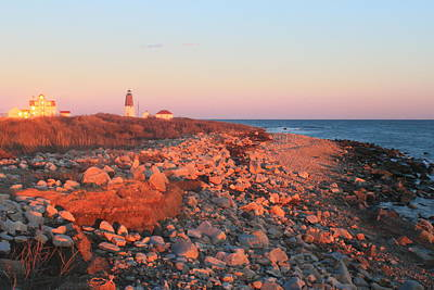 Photograph - Point Judith Lighthouse And Rocky Beach In Evening Light by John Burk