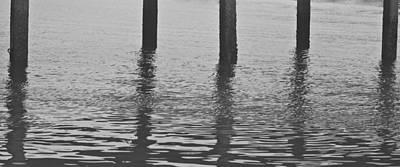 Wood Pylons Photograph - Poles Apart by Georgia Fowler