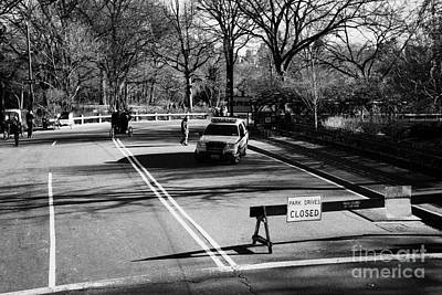 police SUV car patrol with park drives closed sign at the entrance to Central Park new york city Art Print by Joe Fox